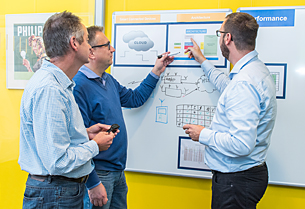 One of our experts helping customers to architect products into a digital IoT system
